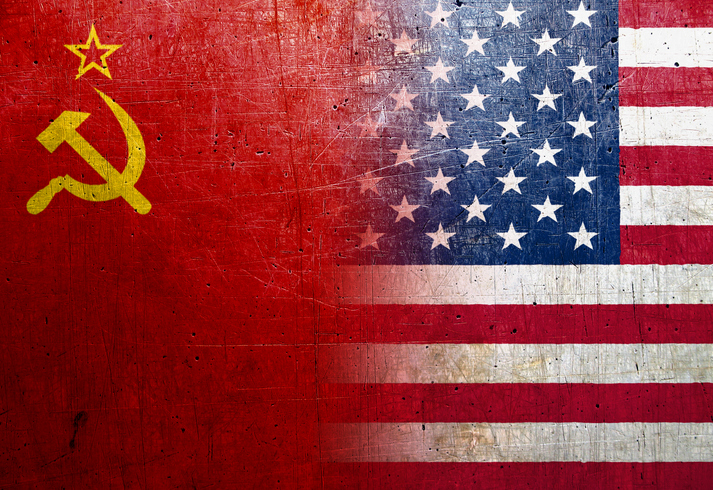 Soviet Union and United States flags on the grunge metal background